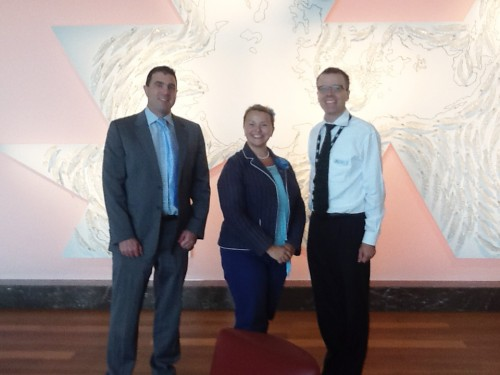 With Glen Toohey and David Atkins at the Australian Government in Canberra.  (The artwork depicts the world map from shifting global perspectives).